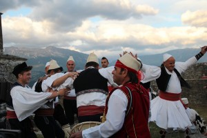 Men dancing and mountain