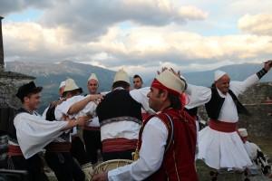 Men dancing and mountain